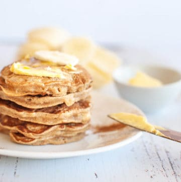 a stack of 5 banana pikelets with butter