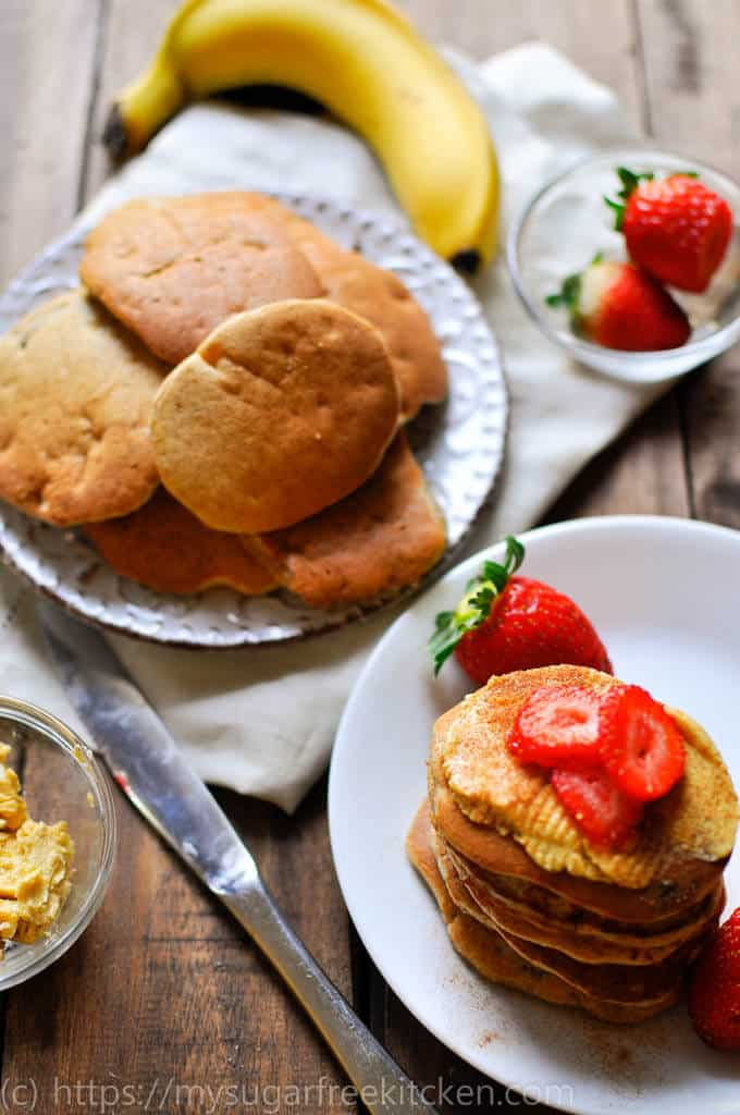 a stack of sugar free pikelets with vanilla butter and strawberries