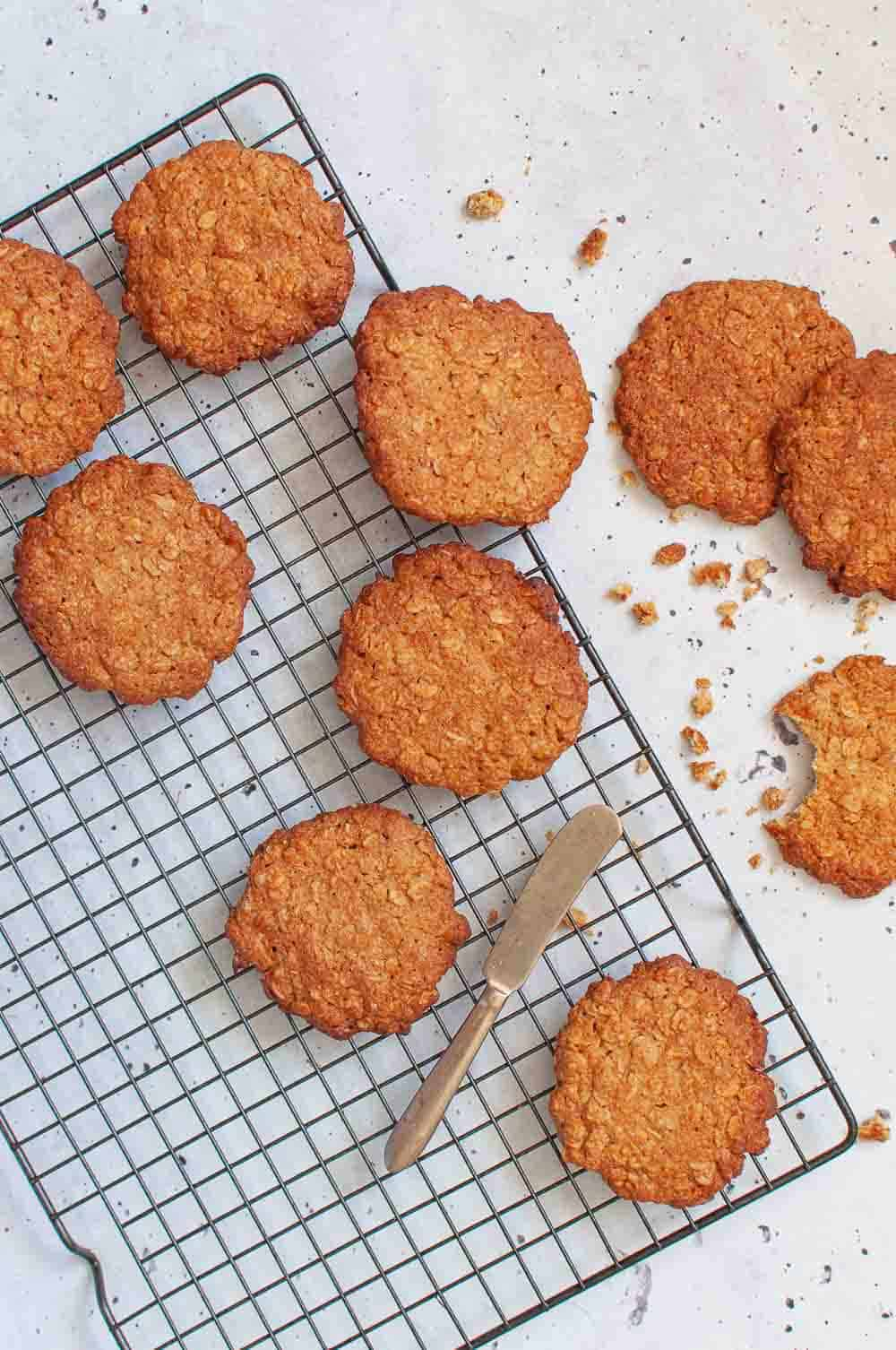 Healthy anzac biscuits on a cooling rack