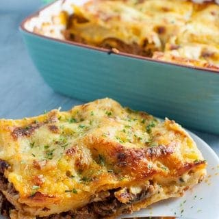 Lasagne without ricotta made with homemade white sauce and rich tomato meat sauce.
