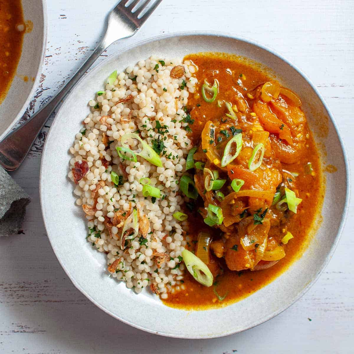 Apricot chicken curry with rice in a bowl