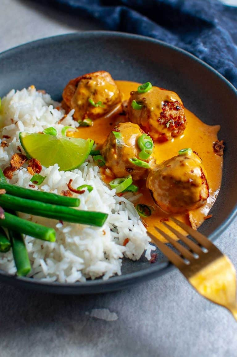 Thai Chicken Meatballs With Peanut Sauce in a bowl with rice