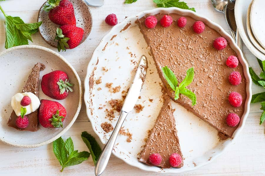 Sliced chilli chocolate cheesecake in a white dish