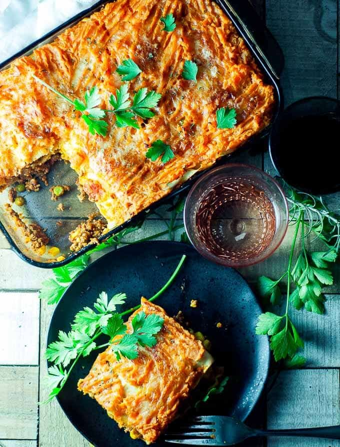 dish with shepherd pie lasagne with a slice taken out