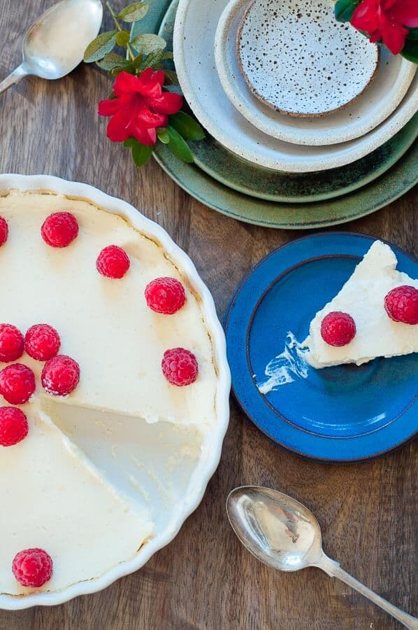white dish with cheesecake slice taken out