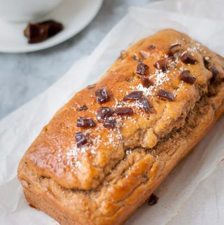 A whole healthy date loaf on baking paper