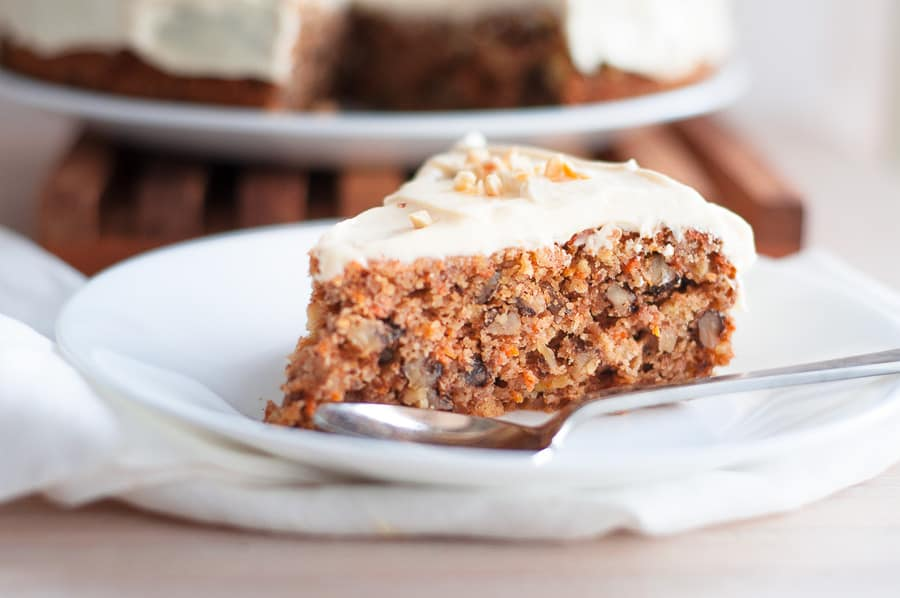 A single slice of low carb carrot cake on a plate
