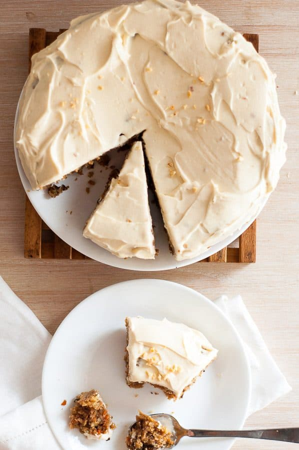 carrot cake with cream cheese on a white plate
