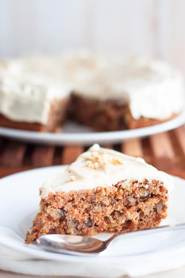 A slice of low carb carrot cake on a white plate