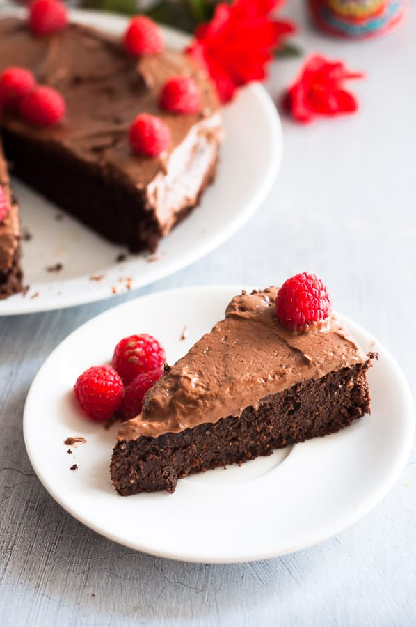 A slice of gluten free mud cake on a plate