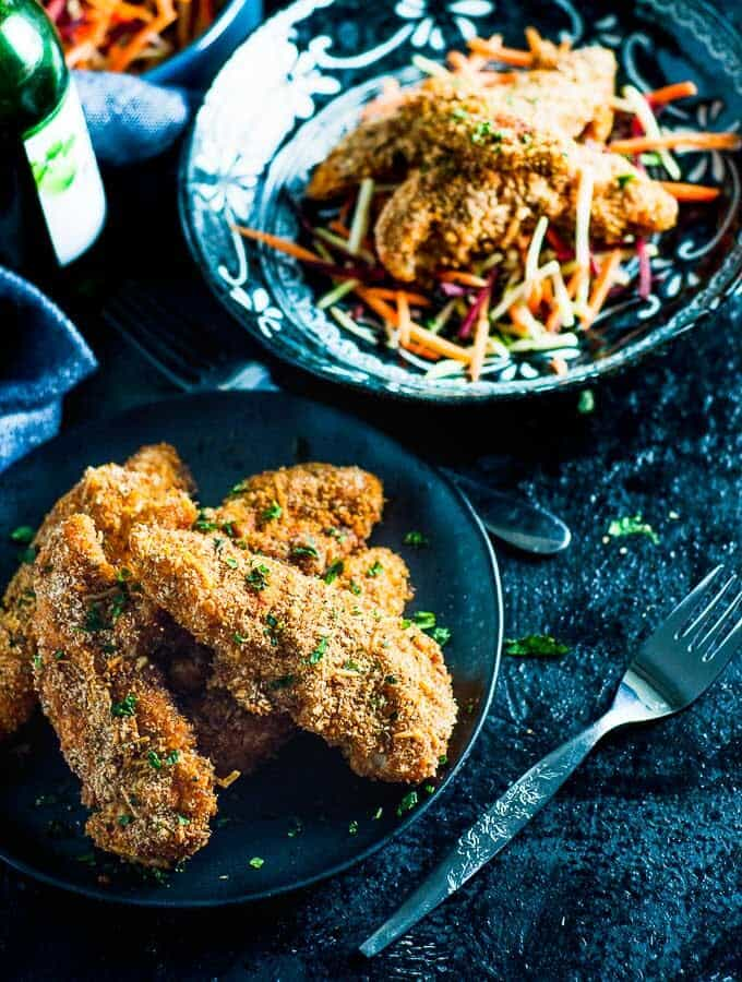 2 bowls of Baked Parmesan Paprika Chicken and coleslaw