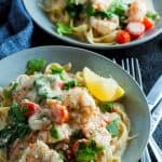 Creamy garlic prawn fettucine in a blue bowl