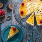 no bake passionfruit cheesecake on a serving platter