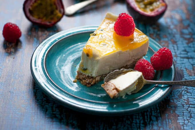 a single slice of no bake passionfruit cheesecake