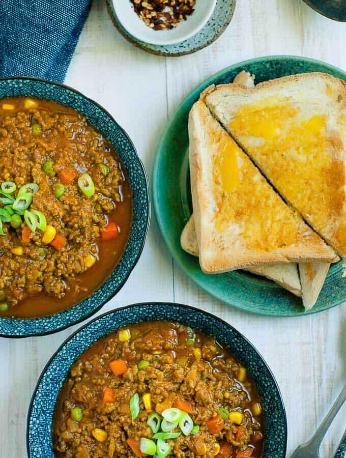 2 bowls of savoury mince curry with toast