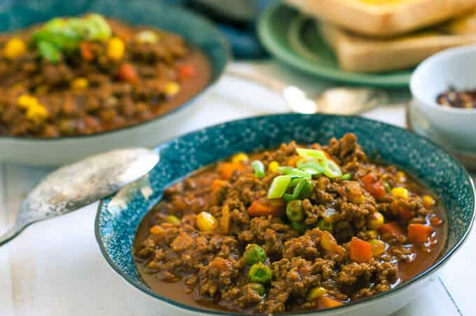 blue bowl and spoon with savoury mince curry