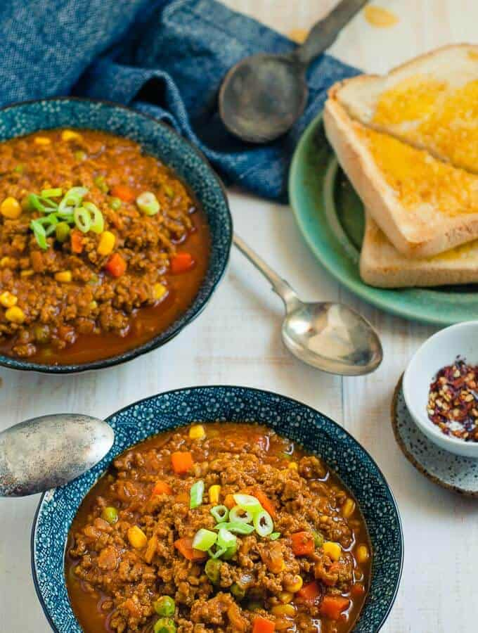 2 blue bowls with savoury mince curry