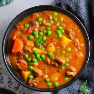 lamb stew in a black bowl