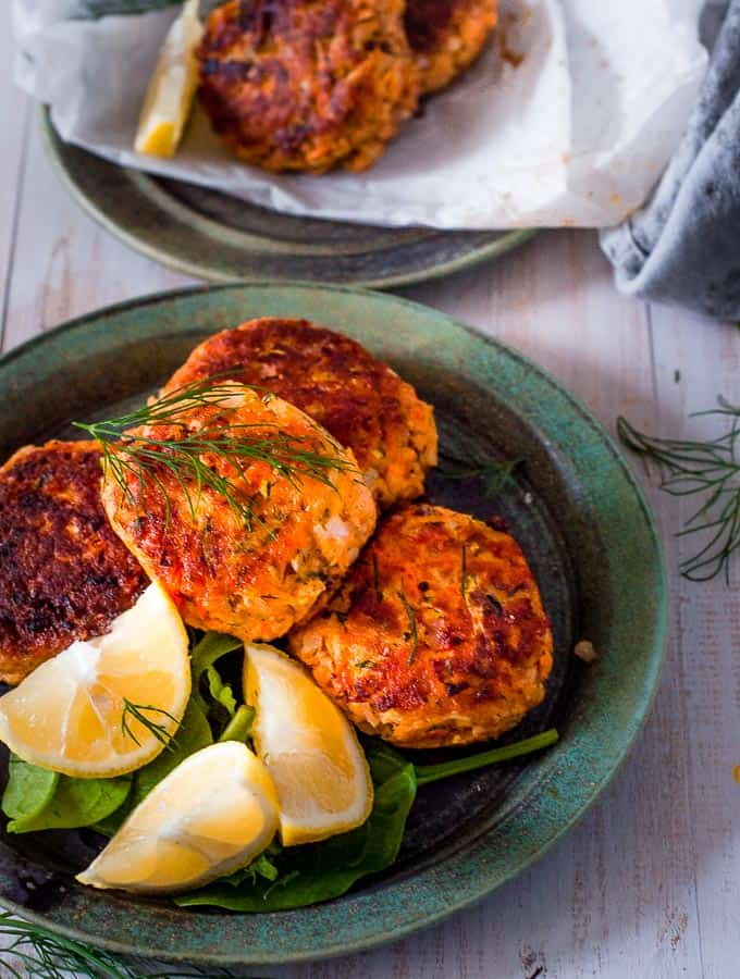 salmon fritters on a plate with lemon
