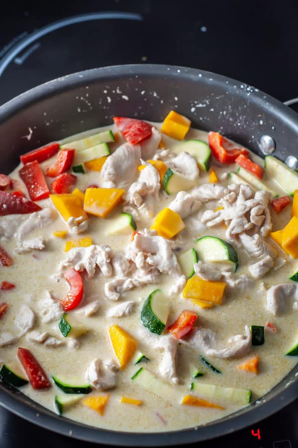 thai green chicken curry cooking in a pot