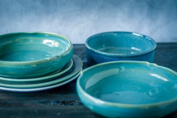 A collection of blue green empty bowls