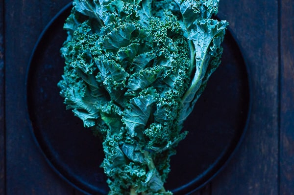 A bunch of kale on a dark background