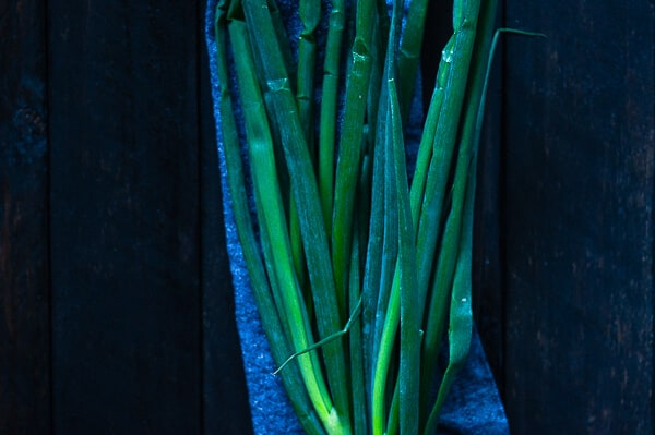 A bunch of shallots on a blue towel