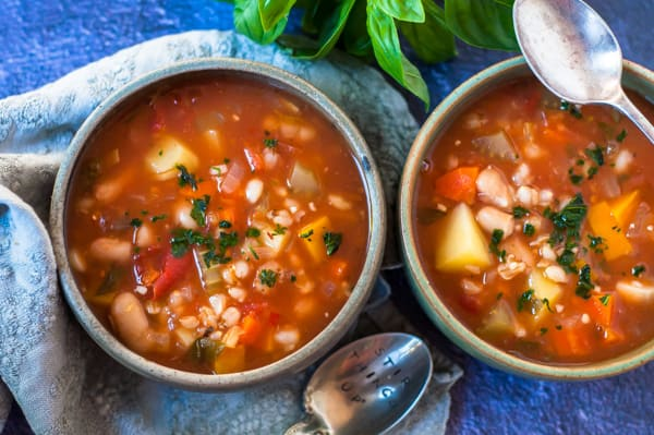 Two bowls of vegetable barley soup