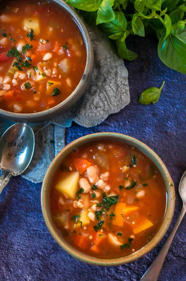 Vegetable and barley soup in 2 bowls
