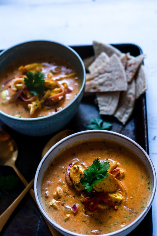 Indian coconut chicken curry on a tray