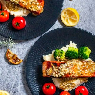 Lemon garlic butter salmon on black plate