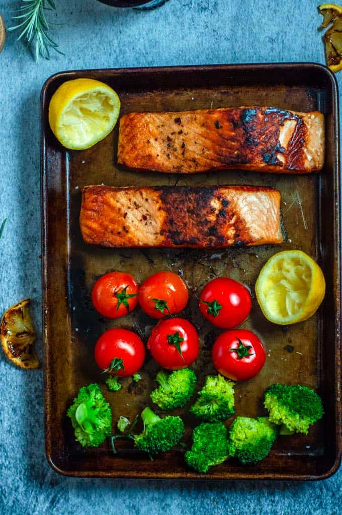Cooked salmon and veges in baking tray