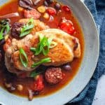 Spanish chicken tray bake in a blue bowl