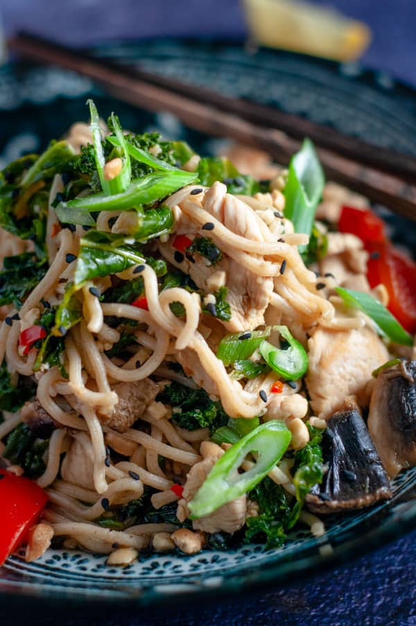 Chicken and kale stirfry with noodles in a bowl