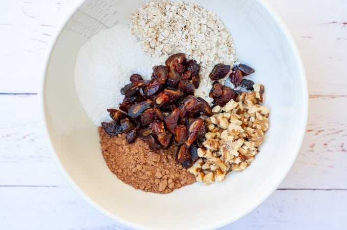 Chocolate date slice ingredients in a bowl