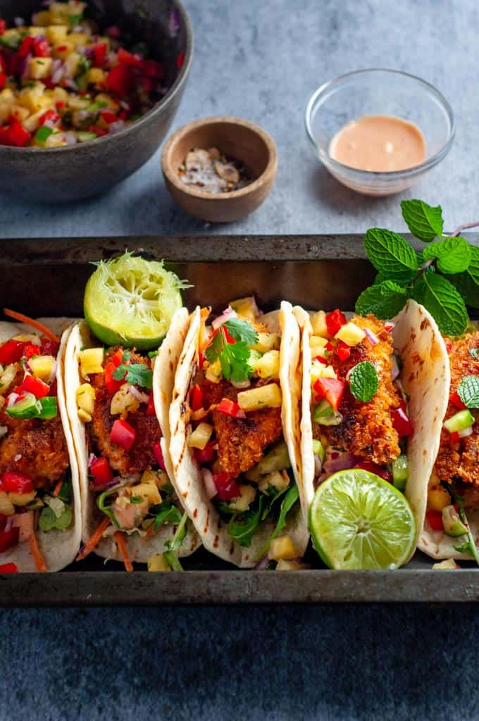 fish tacos with pinapple salsa and lime