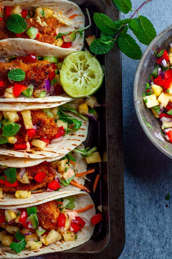 Fish tacos with pineapple salsa in a tray