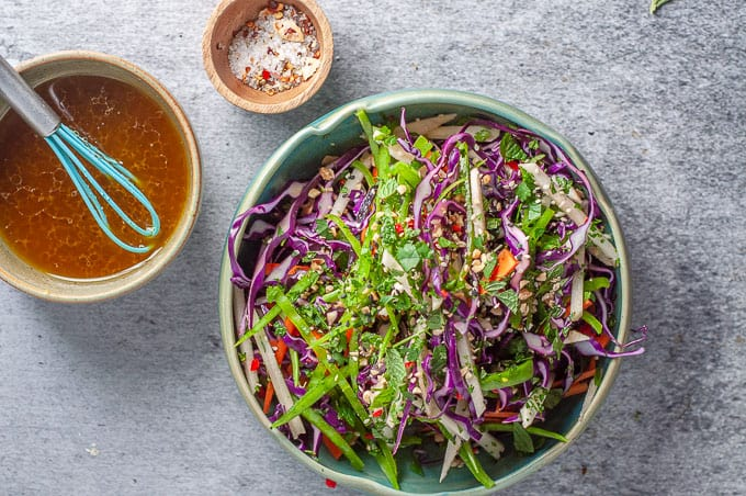 a bowl of asian slaw with dressing