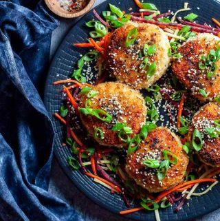 chicken rissoles on a black plate