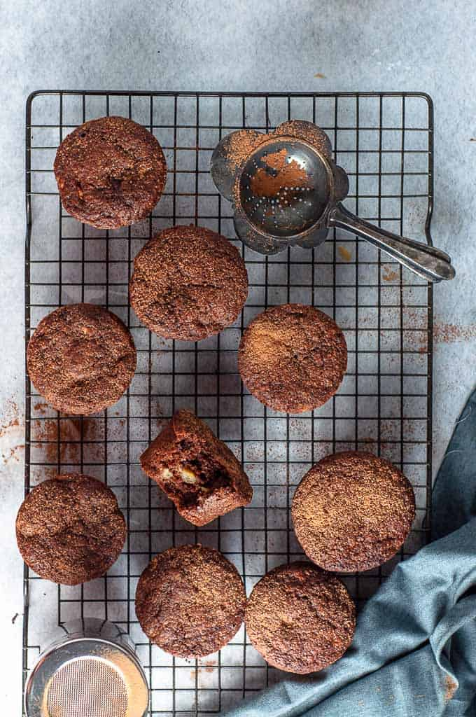 Double chocolate banana muffins on a wire cooling rack