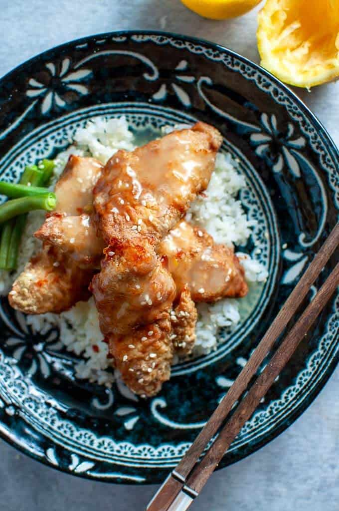 asian lemon chicken with lemon sauce drizzled over