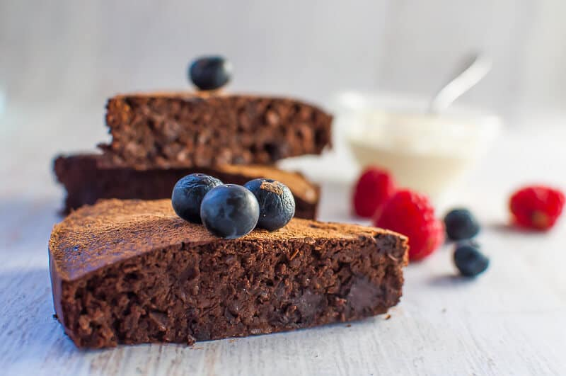 a slice of Black Bean Chocolate Cake with blueberries