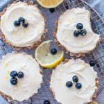 Mini lemon tarts on a wire rack