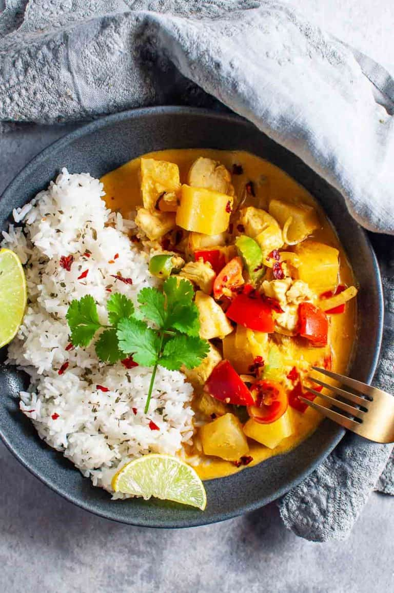 A bowl of pineapple curry chicken and rice