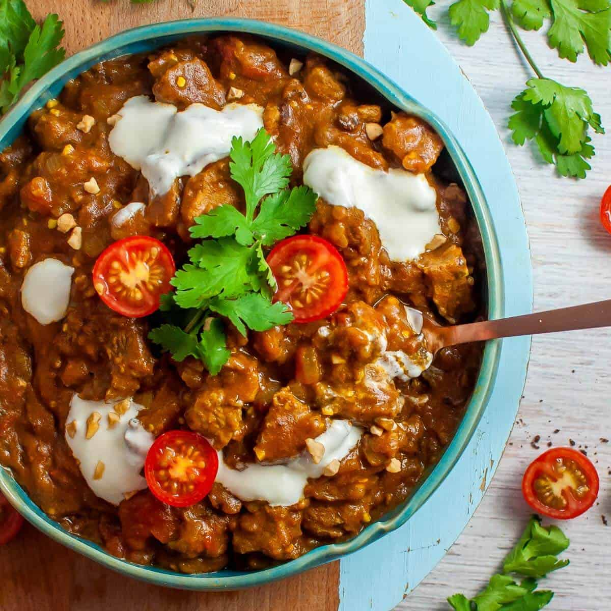 beef masala with tomatoes in a bowl