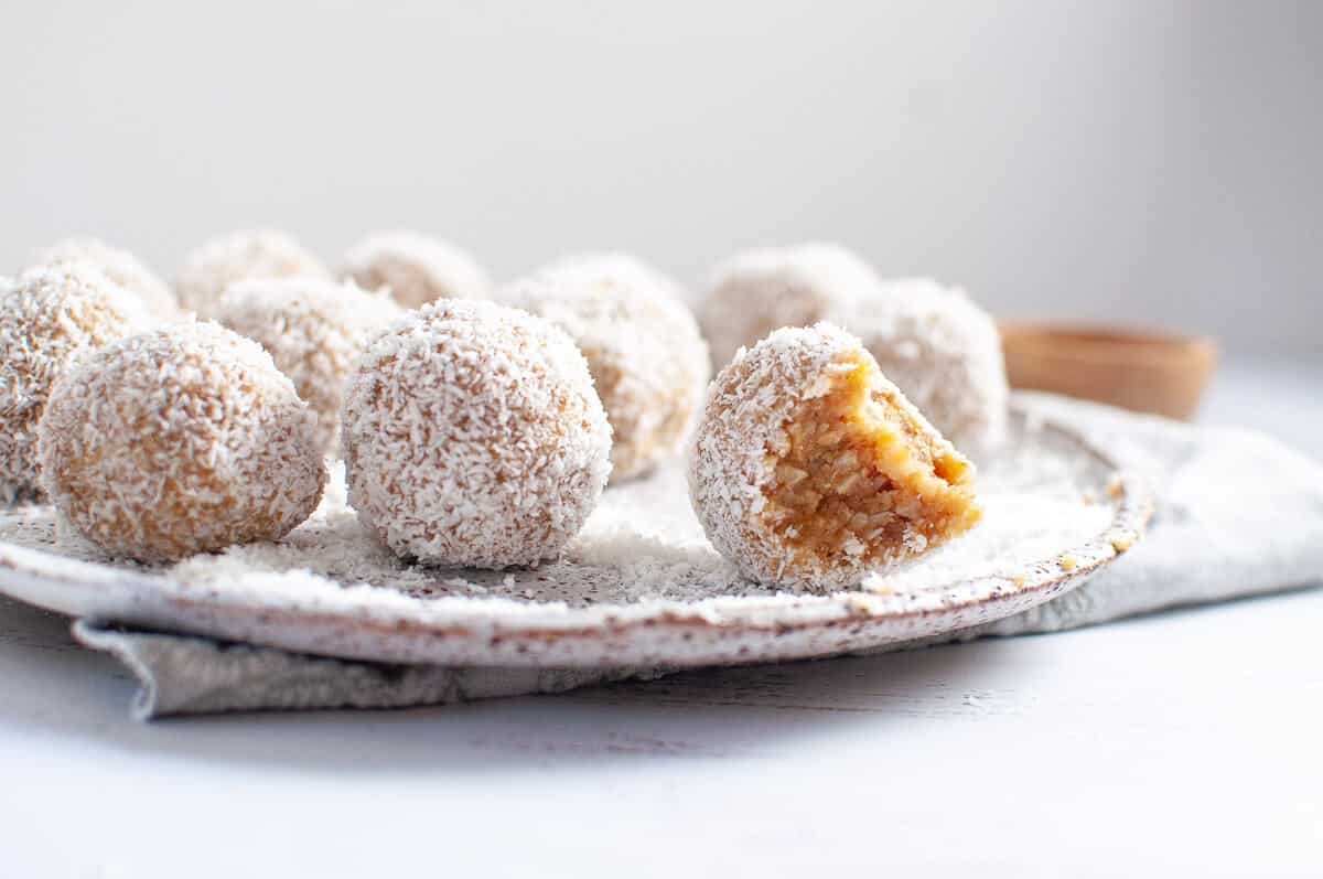 lemon coconut bliss balls on a plate