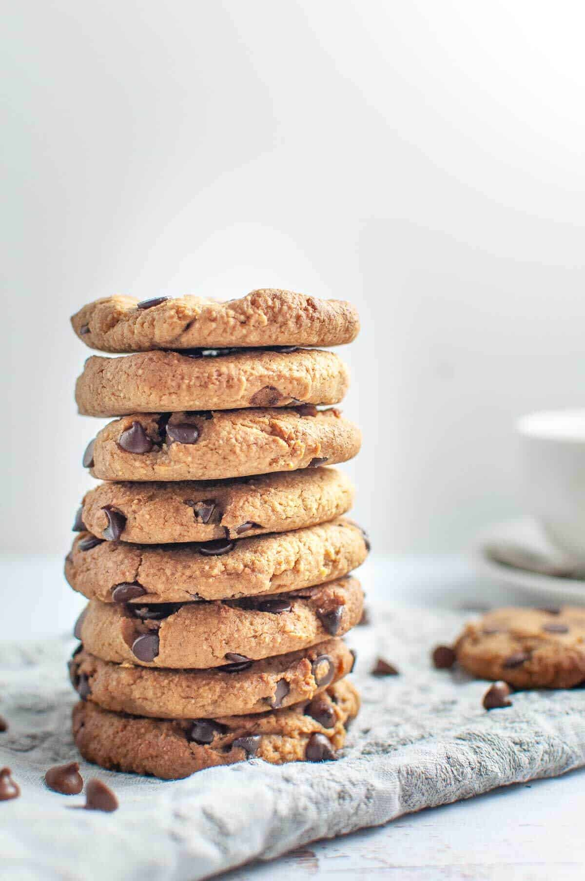 Chickpea Chocolate Chip Cookies stacked on a napkin
