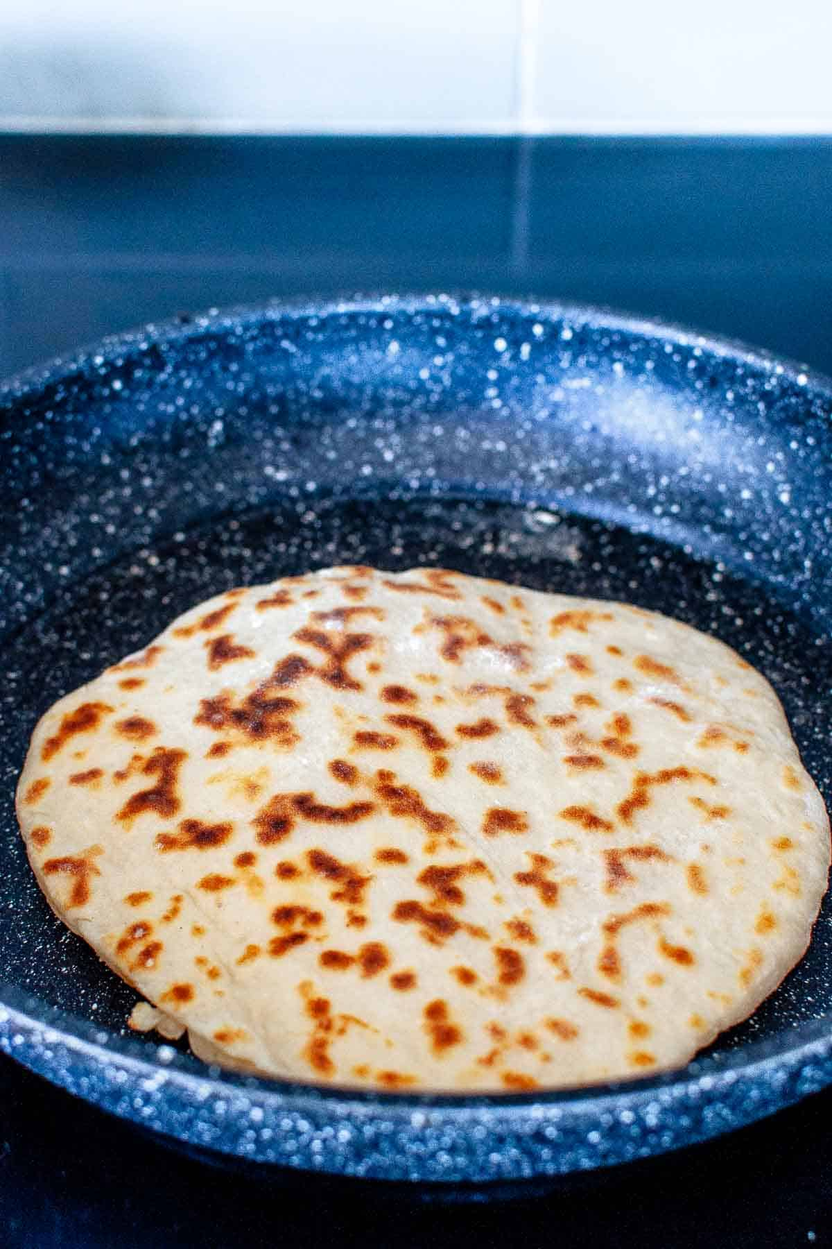 Cooking flatbread in a pan