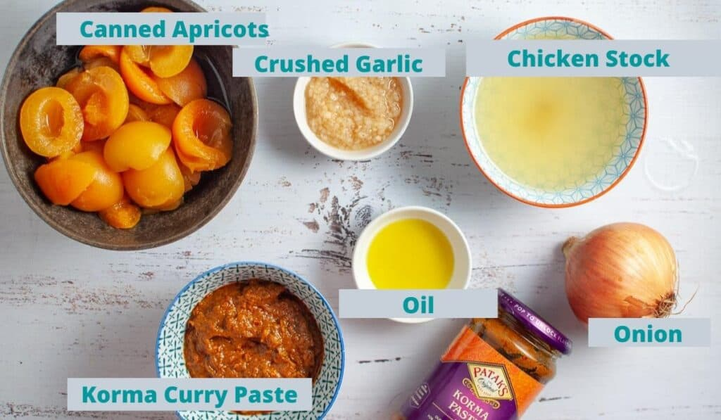 Apricot chicken curry ingredients on a table