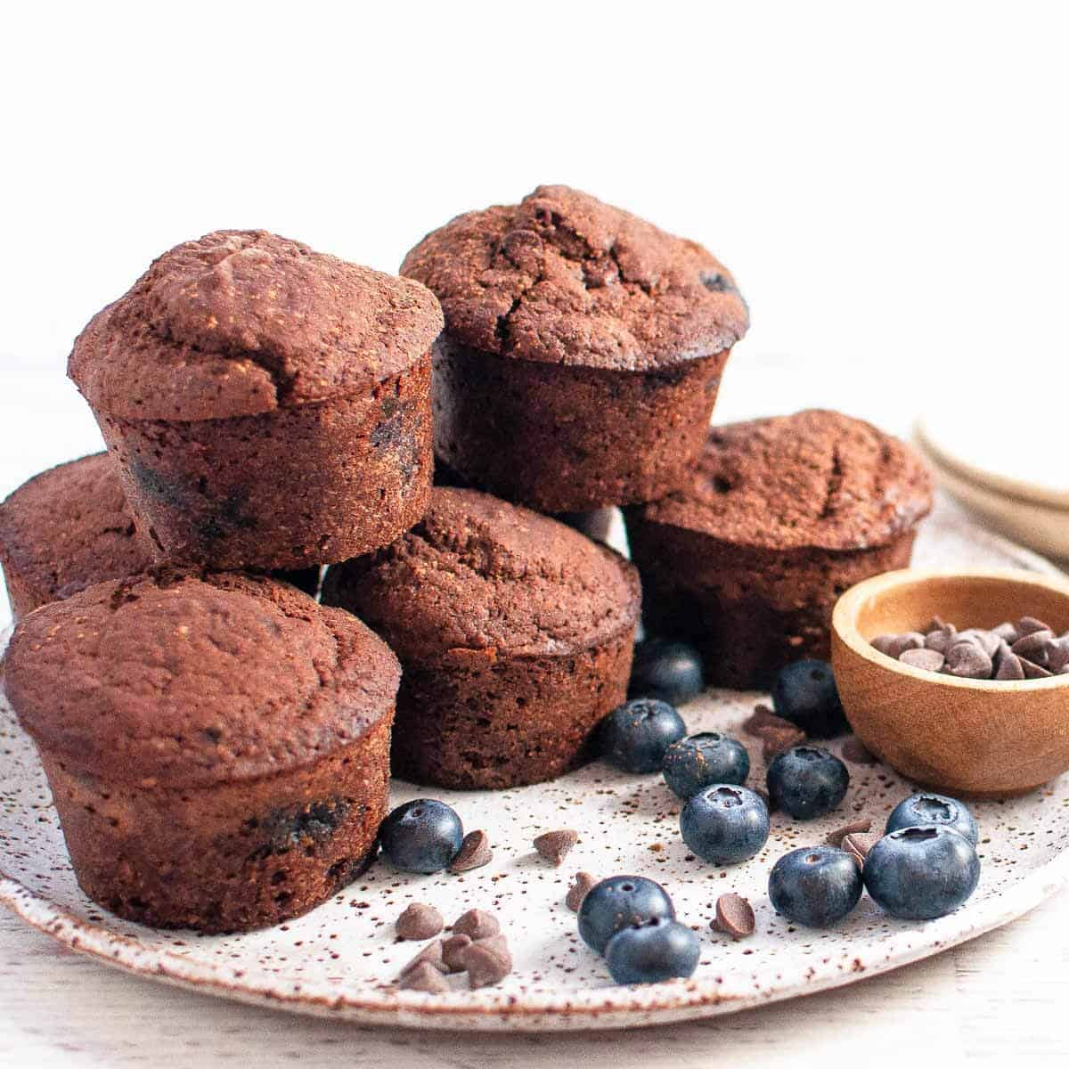 Chocolate blueberry muffins on a plate